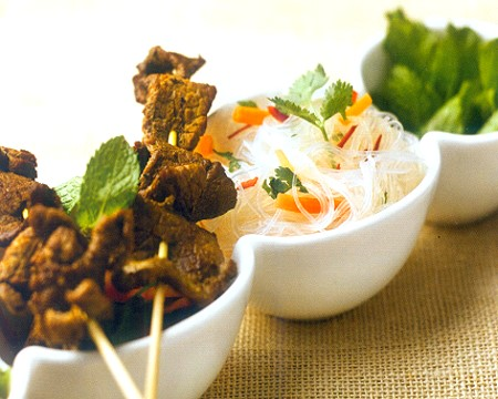 Vietnamese noodles salad with beef skewers